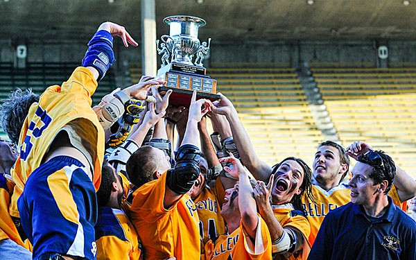 Bellevue holds up its Washington state championship trophy.